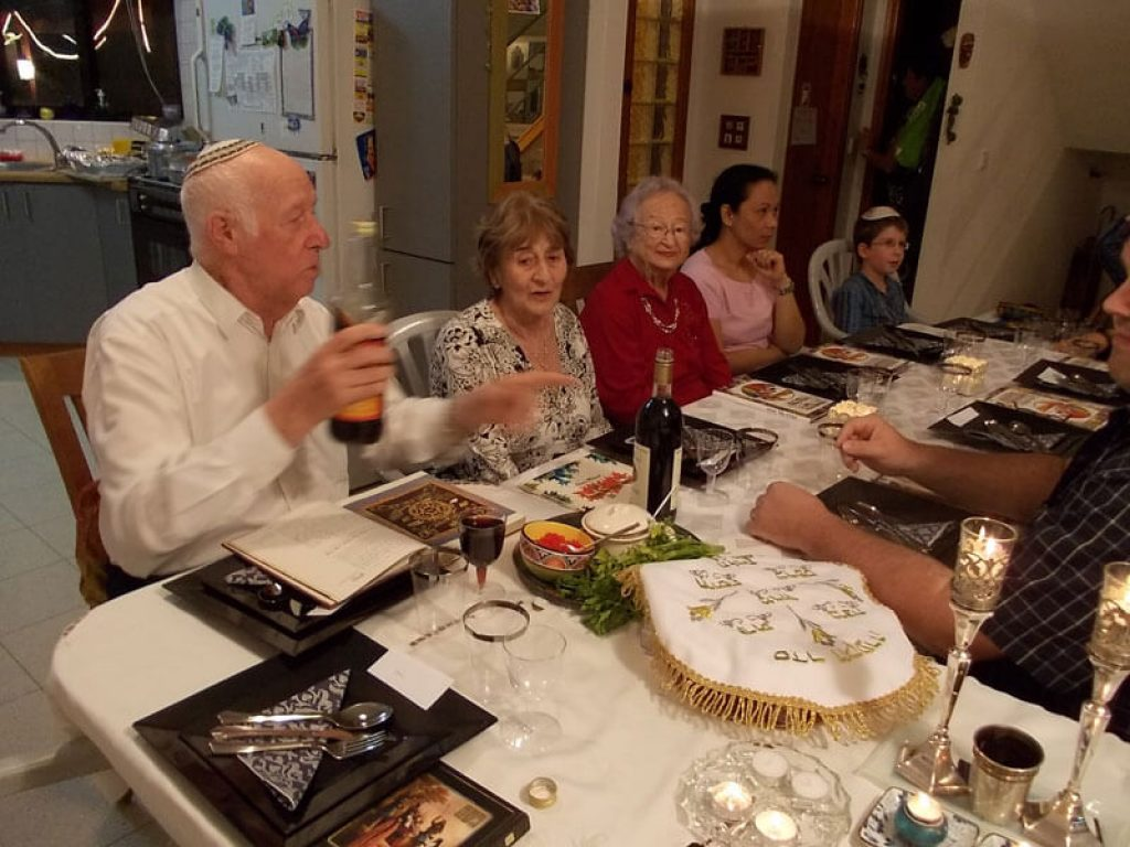 my own family starting the seder nightwith the filling of wine glasses