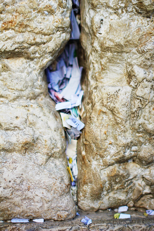The cracks of the Wall filled with prayers